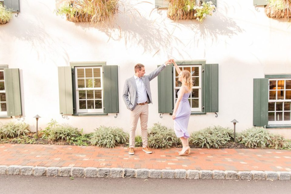 couple dances during engagement session in New Hope