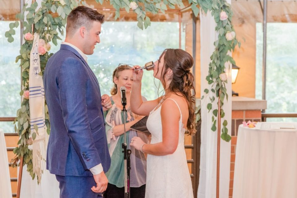 bride drinks toast during PA wedding ceremony