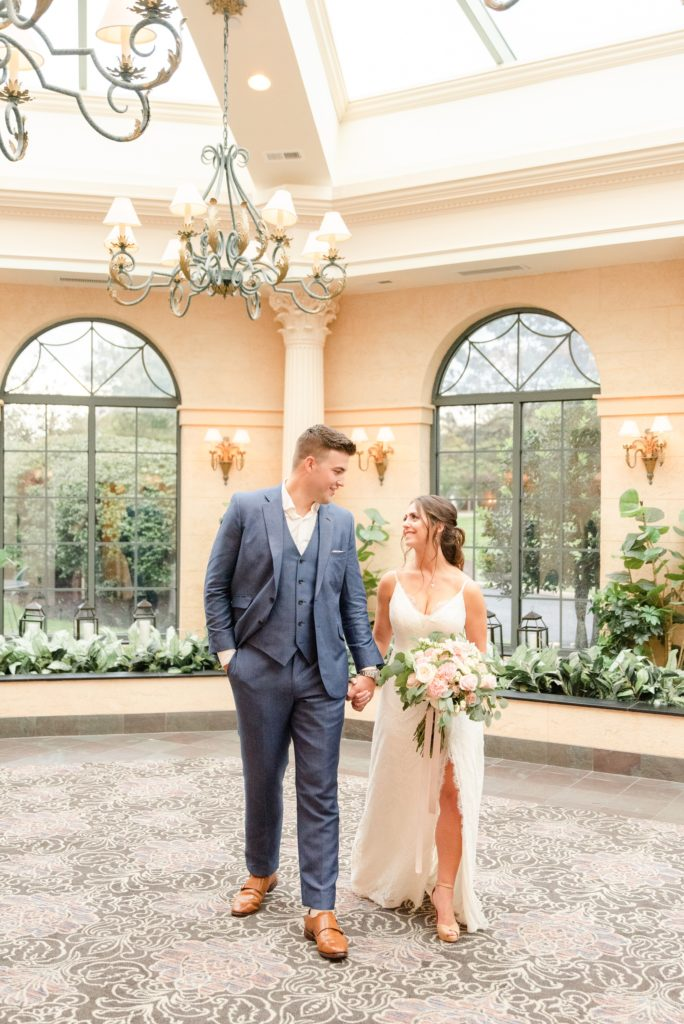 newlyweds walk through lobby of hotel Desmond