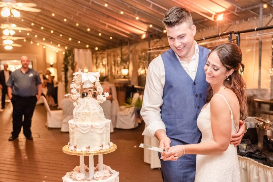newlyweds cut wedding cake at Hotel Desmond