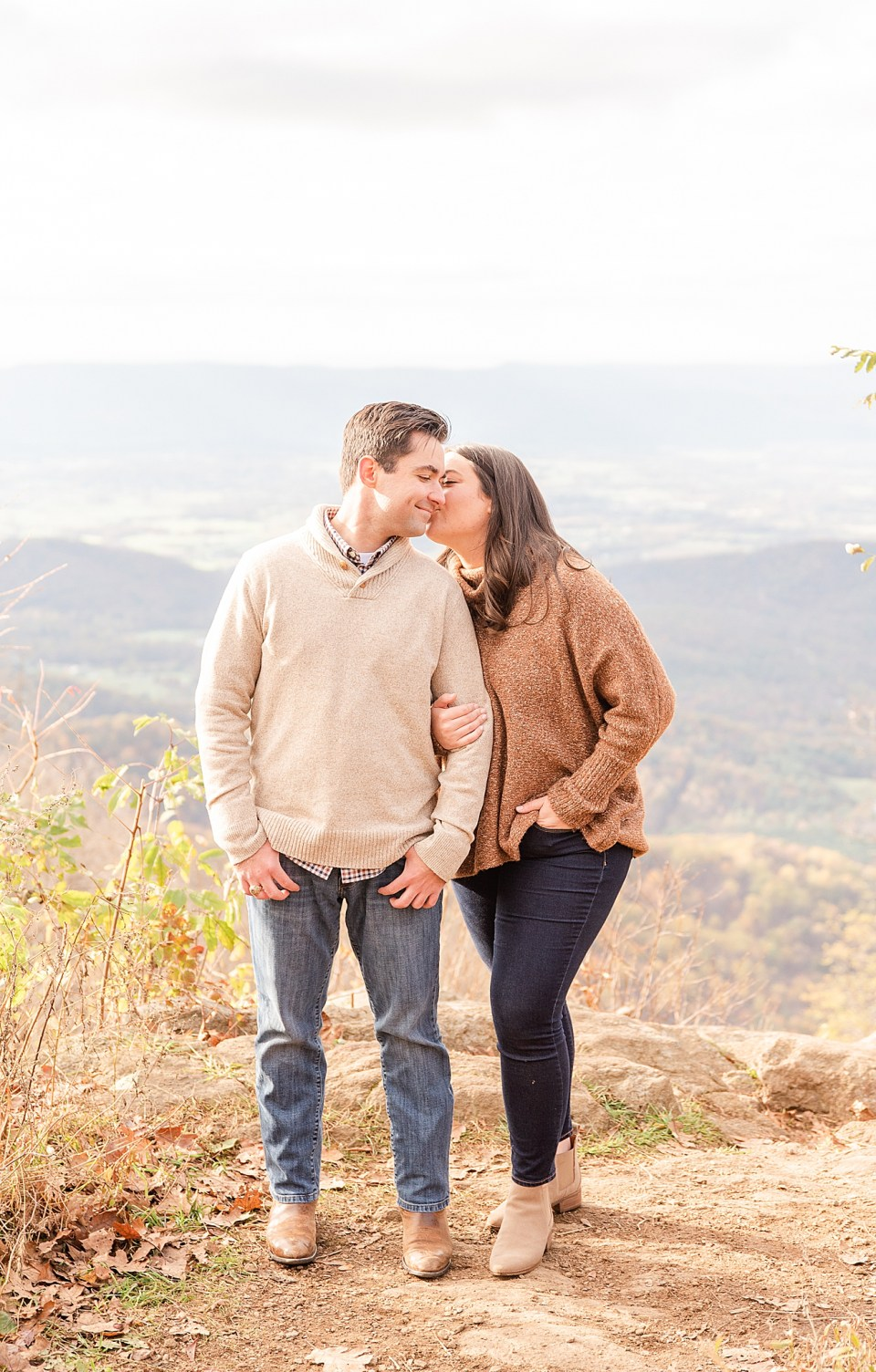 bride kisses groom's cheek during VA engagement photos