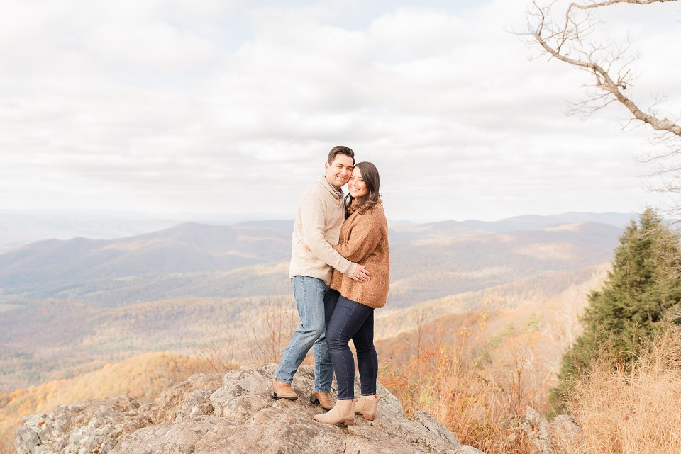 bride and groom pose on top of rocks at Shenandoah National Park