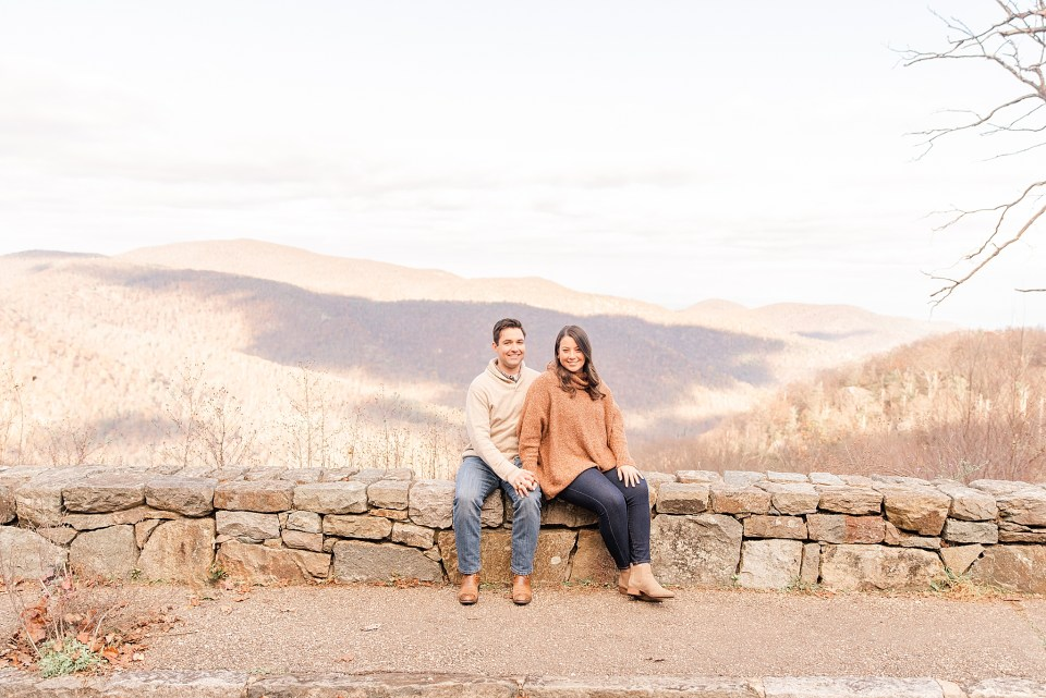 couple sits on skyline drive