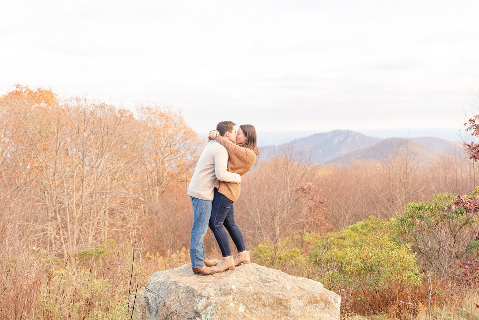 bride and groom kiss during fall Shenandoah National Park engagement photos