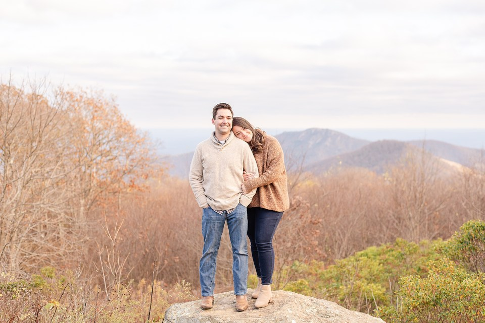 bride leans on groom's shoulder during VA engagement session