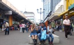 A family enjoying ice cream on a San José walking street