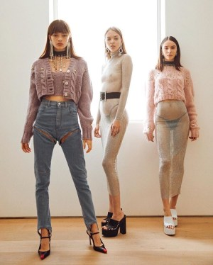 three girls wearing designer pieces