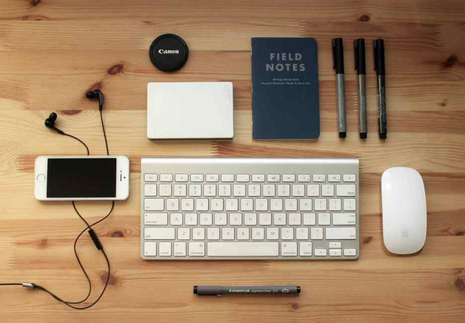 Keyboard, mouse, phone and notebook