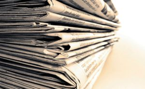 huge-stack-of-news-papers