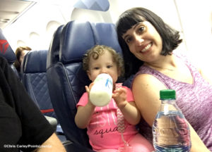 Mother and daughter sitting in first class on a Delta Air Lines flight
