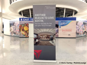 "A sign reading ""Another Reason to Love Austin"" is seen outside the Delta Sky Club Austin airport lounge at Austin-Bergstrom International Airport (AUS) in Austin, Texas. Photo © Chris Carley / PointsLounge"