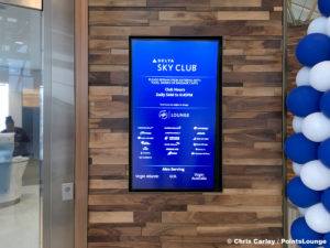 A sign with opening and closing hours, plus admission policy, is seen outside the Delta Sky Club Austin airport lounge at Austin-Bergstrom International Airport (AUS) in Austin, Texas. Photo © Chris Carley / PointsLounge