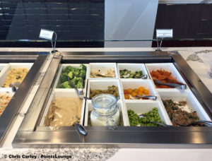 A salad bar is seen at the Delta Sky Club Austin airport lounge in Austin, Texas. Photo © Chris Carley / PointsLounge