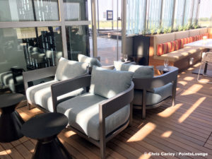 Chaires and tables are seen on the Sky Deck patio of the Delta Sky Club Austin airport lounge in Austin, Texas. Photo © Chris Carley / PointsLounge