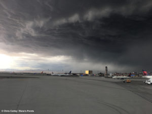 A thunderstorm builds at Las Vegas McCarran Airport, affecting Delta, United, and Southwest flights, as Mandalay Bay and Luxor resorts and casino stands in the distance on the Las Vegas Strip.