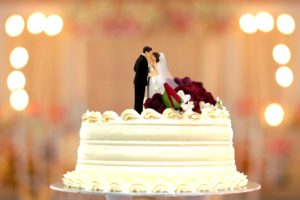 wedding cake bride and groom topper with blur backgroud image