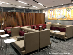 A seating area with tables and booths are seen inside the Delta Sky Club Austin airport lounge at Austin-Bergstrom International Airport (AUS) in Austin, Texas. Photo © Chris Carley / PointsLounge