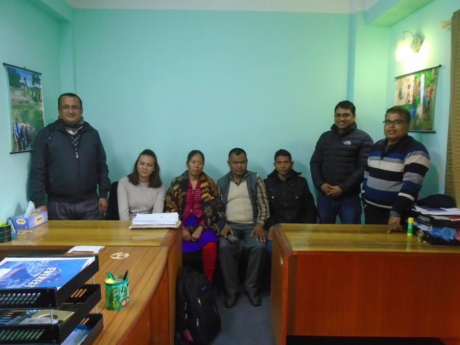 Renewable World project staff and community members from Jugedhara at the technical contractor's office
