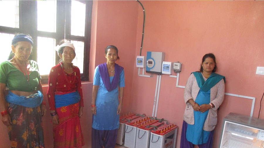 Health post workers and community members with the new solar system and fridge