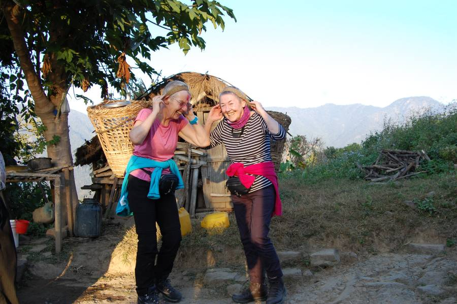 Sue and Elaine fetch water from the source and take it to the community.