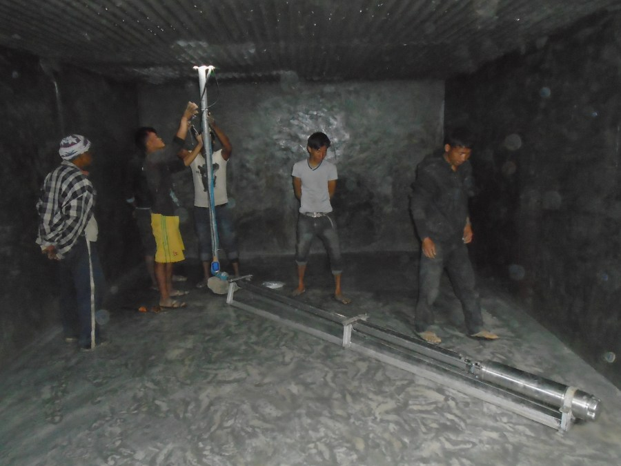 Five men work together in installing wiring for the solar-powered pump in Jugedhara.