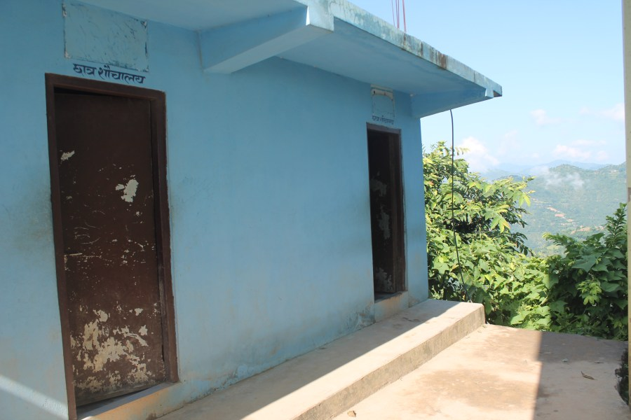 An outside view of the poorly maintained toilet building at the school.