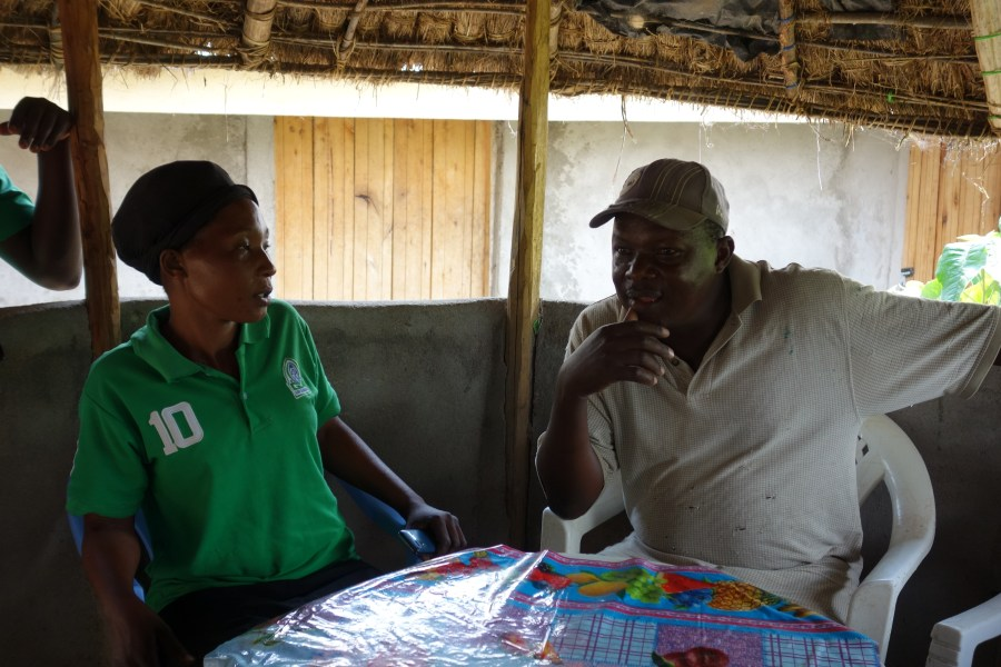 Diana in discussion with a community member.