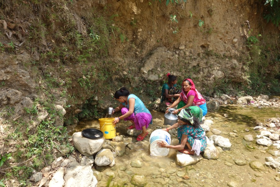 Women collect water for the community in Sanneghari