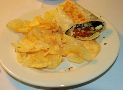 The Greek tomato pie wrap with kettle chips.