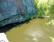 The pool at the base of DeSoto falls. The crevice in the rock may lead to a larger cave