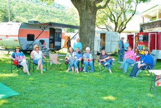 """Sisters on the Fly pose for a group photo. These ladies practice the art of """"glamping,"""" or glamor camping decorating and staging their campers with different themes."""