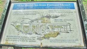 How the Iron Furnace would have looked in operation. Water from Roaring Run powered the huge water wheel.