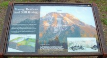 Information sign with photo of Mount Moran, and a brief explanation of the local geology.