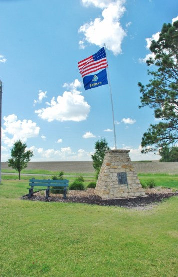 A Stone Monument documents the Center of the 48 contiguous United States, which is actually, unmarked, about one-half mile in an adjacent cornfield.