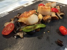 Scallops on bed of assorted mushrooms
