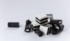 Black and white liquorice alsorts on white foam board