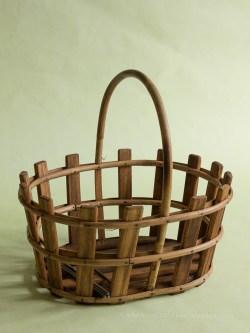 Basket in portrait with window light on green paper