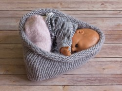 Baby nest on floor boards - the floor boards take the focus from the baby.