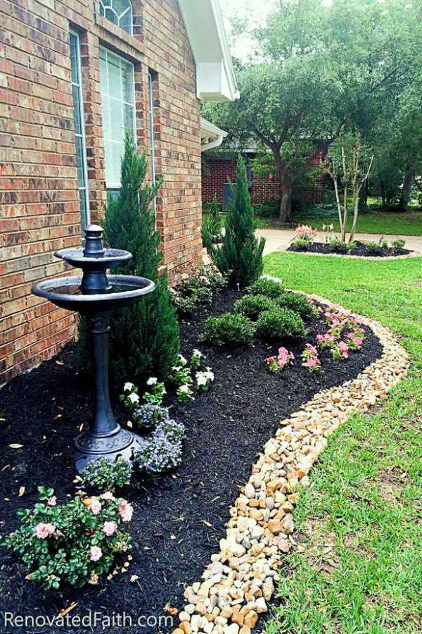 DIY Landscape Design – Want to save money by landscaping your yard but don't know where to start? Planning your own landscape design can be overwhelming but these simple front yard landscaping ideas will give your yard a professional look without while staying on budget. #frontyardlandscapingideas #frontyardlandscapingideaswithstones #landscapearchitecture #smallfrontyard www.renovatedfaith.com