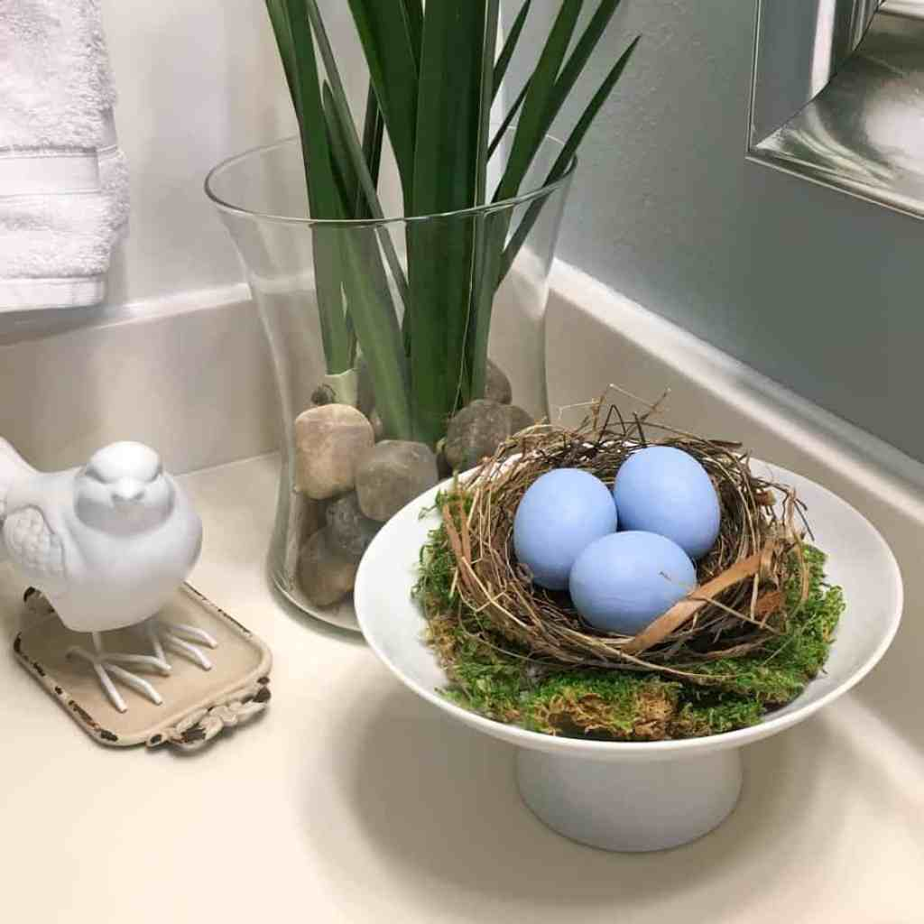 Bird Nest Decor / DIY Framed Nest Art - What is it about bird's nests that are so inviting? Maybe it's the hint of spring or the thought of something new and wonderful on the horizon.This post will help you implement some bird's nest decor ideas in your home as well as make your own DIY framed nest art. #diyframedart #nestwallart #birdnestdecor #birdnest #renovatedfaith www.renovatedfaith.com