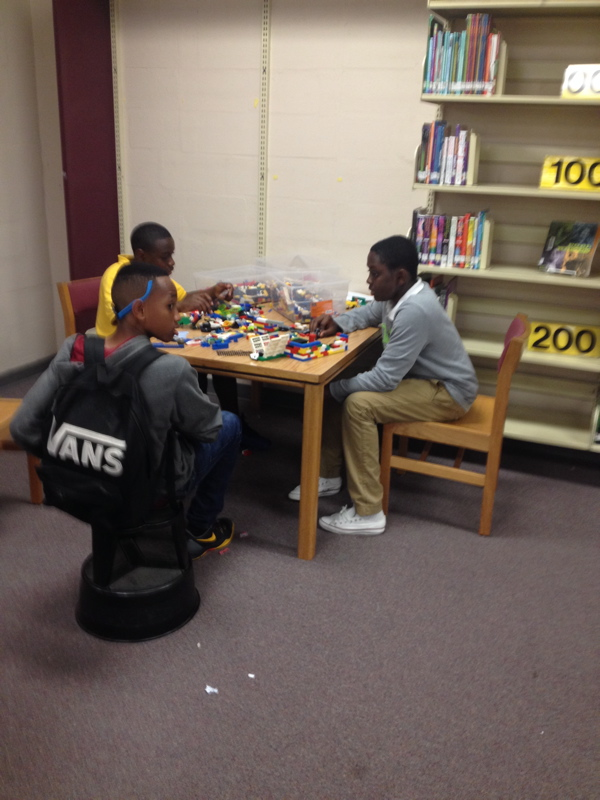 Students tinkering with LEGOs