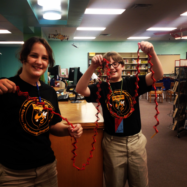 Students showing off a K'nex chain