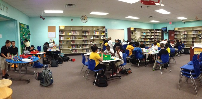 Students using our new tables and chairs during 6th grade STEAM club