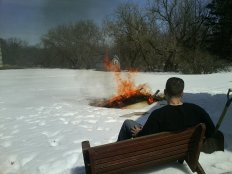 Joe and I burning what was safe to burn of the house debris - taking a break.