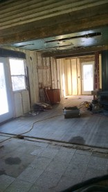 Here's the kitchen again, right in the middle is where our island will be... as soon as I make it... God I just can't wait to be building and refinishing furniture again! I miss it SO much! (kudos to Mike Day of Day's Foam It for doing such a nice job)