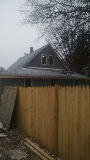 A determined Joe braved an incredibly slick roof and sleet and rain and snow to get the south end siding on Sunday!