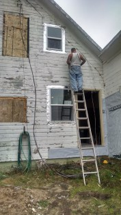 Joe prepping the north side of the house for siding.