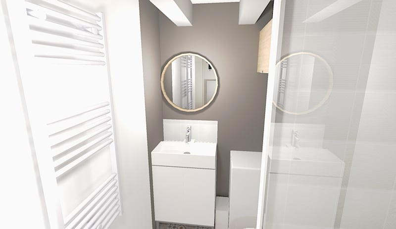 Le carrelage, qui imite des carreaux de ciment, et le mur peint dans un ton soutenu apportent une ambiance spa à cette petite salle d'eau.