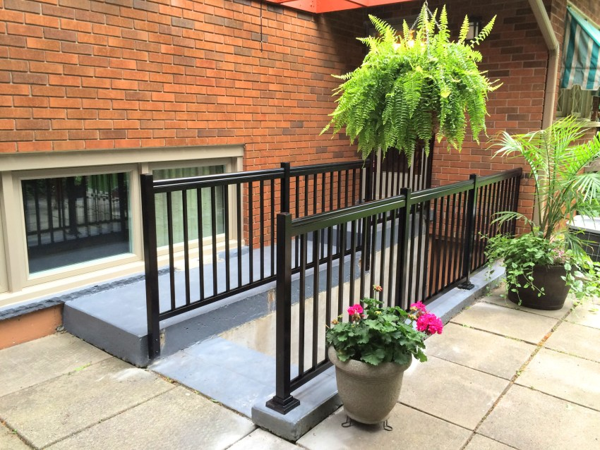 Renaissance Rail aluminum spindle railings, black, on a concrete basement entrance in Ancaster, ON