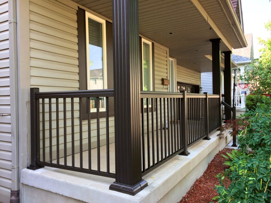 Renaissance Rail aluminum spindle railings and aluminum columns, brown, on a concrete front porch in Burlington, ON